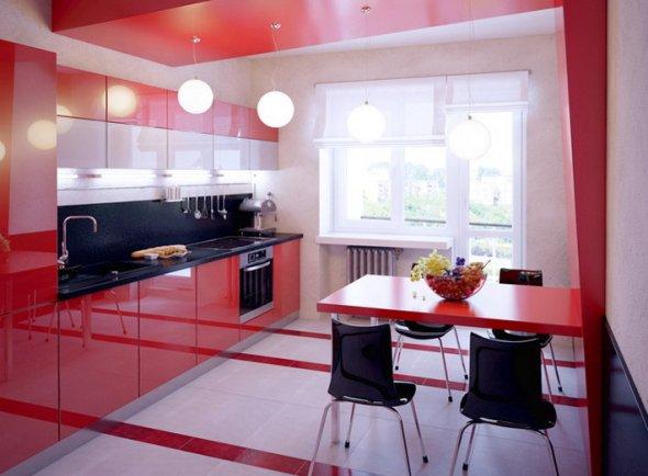 Дизайн кухни с ярко-красными деталями интерьера.