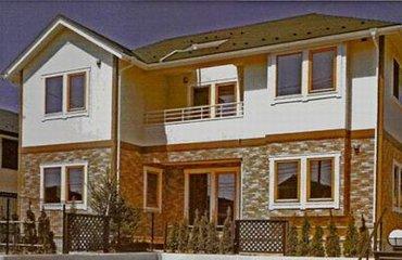 Дом облицованый фасадными панелями