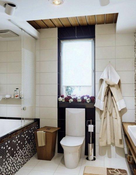 В отделке ванной комнаты использована мозаика