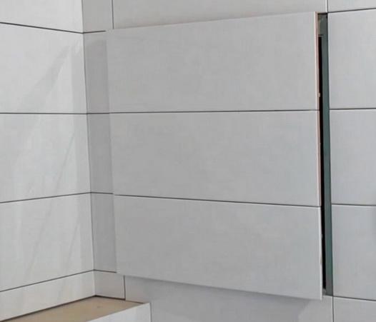 люк из плитки в стене